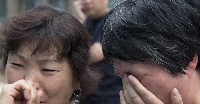 Families of Flight 370 passengers seek information