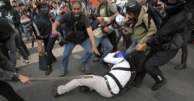 Mexico protesters attack journalists, smash glass