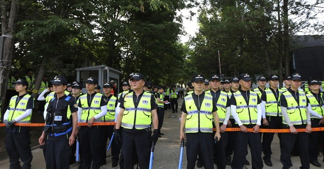 Why so many police used in raid of Korean church?