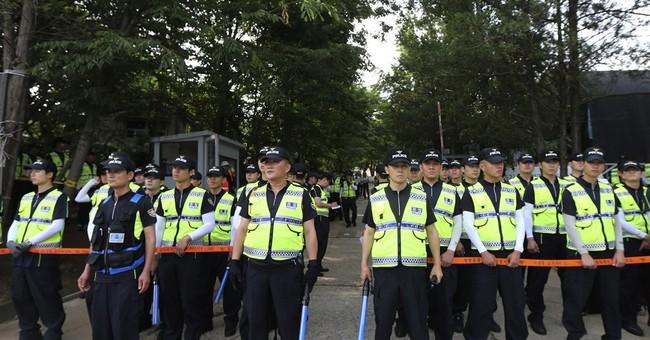 Why so many police used in raid of Korean church?