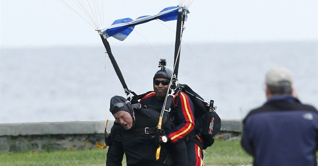 90-year-old ex-president Bush makes parachute jump