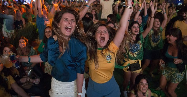 Brazilians jam in front of TVs for World Cup start