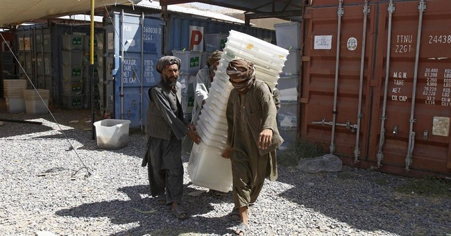 Afghans tighten security as Taliban threaten vote