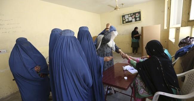 Afghans brave Taliban threats to choose new leader