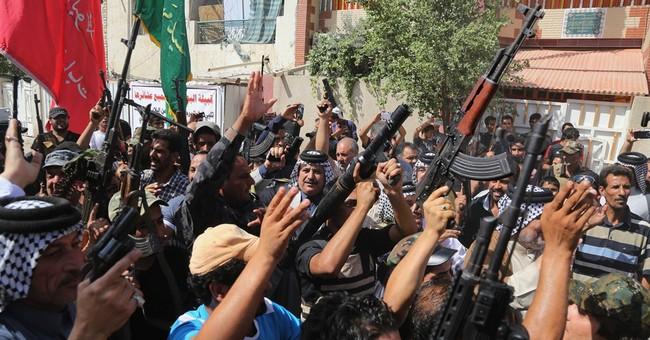 Militants post photos of mass killing in Iraq