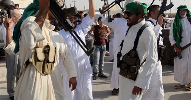 Thousands of Iraqi men answer urgent call to arms