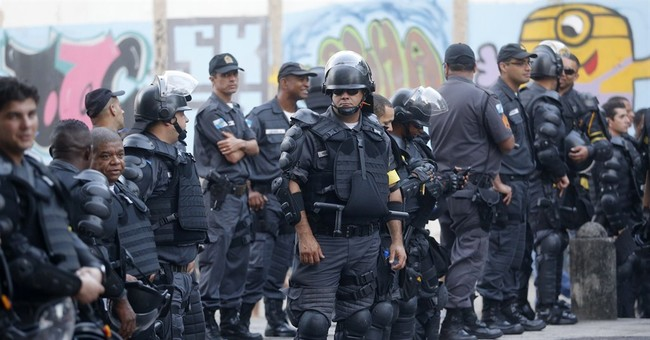 Rio officer shoots live round during Cup protest