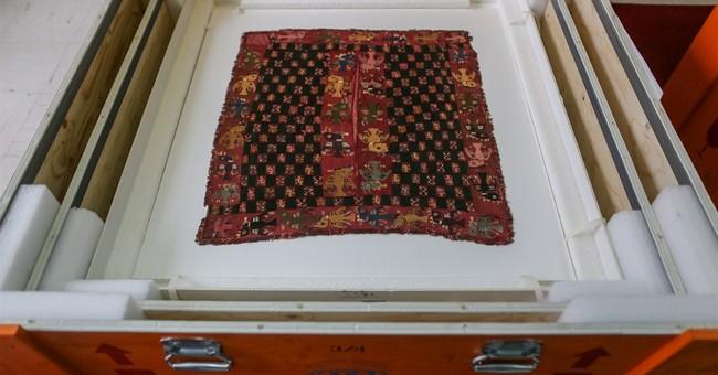 Sweden returns pre-Incan funeral shroud to Peru