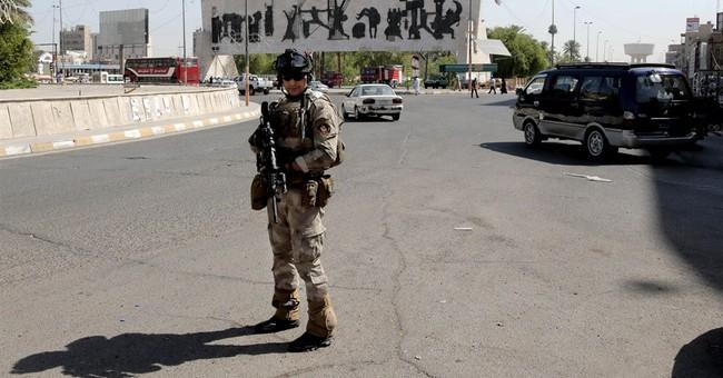 Iran's general in Iraq, militants seize key city