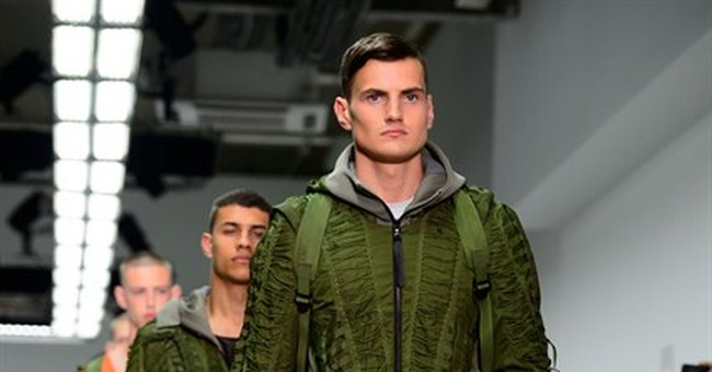McQueen updates classic tailoring at London show