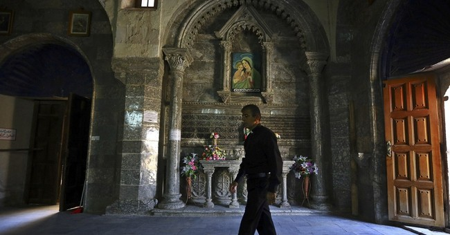 Iraqi Christians flee homes amid militant push