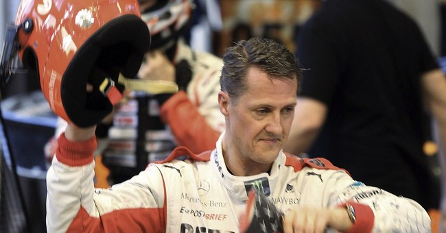 Schumacher leaves French hospital, out of coma