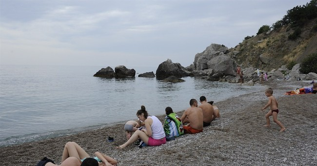 Russia leans on companies to rescue Crimea tourism