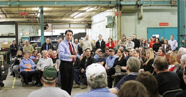 Wisconsin's Walker dogged by a promise not kept