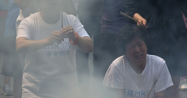 Time deepens agony for Flight 370 relatives