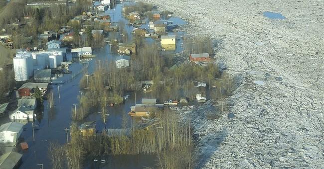A year after flood, volunteers help rebuild town