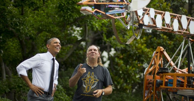Obama, inventors check out electric giraffe