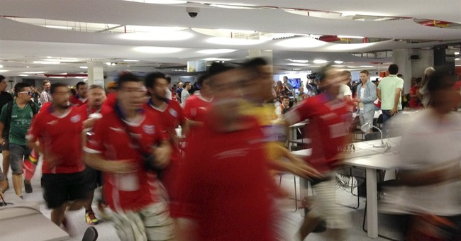 Rampaging Chile World Cup fans bust into Rio venue