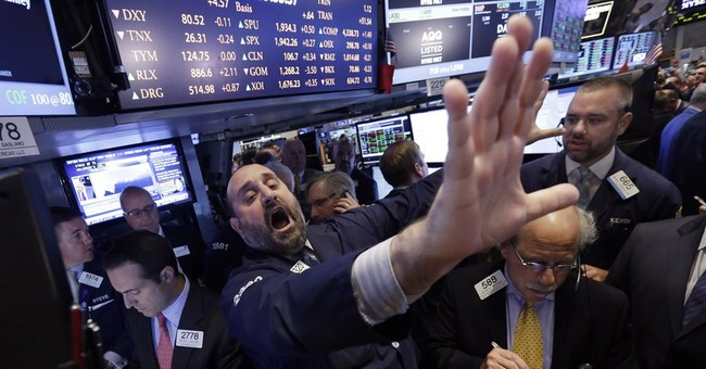Stocks edge higher after Fed trims bond purchases