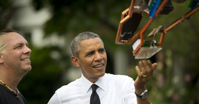 Obama, inventors check out electric giraffe