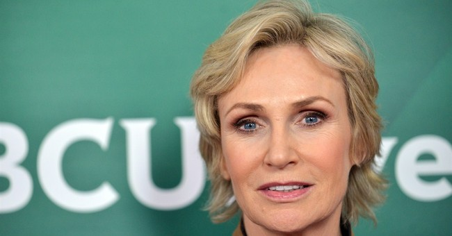 Jane Lynch pulls off her tracksuit to go cabaret