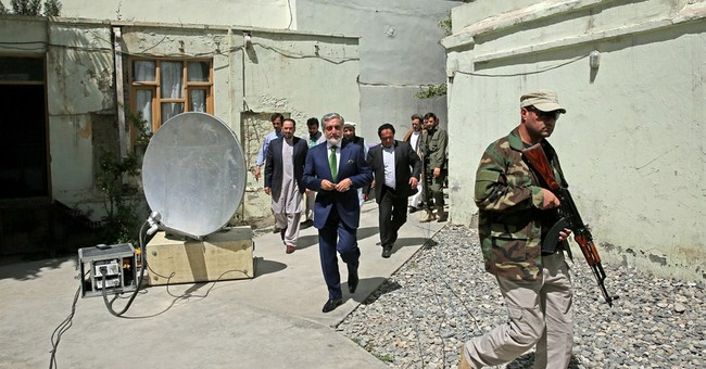 Afghan candidate seeks halt to runoff vote count