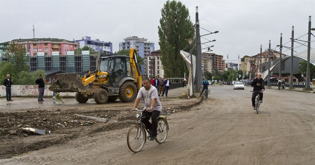 Kosovo Serbs replace barricade with flower pots
