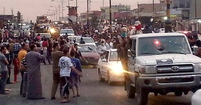 Iraq militants walk fine line in seized areas