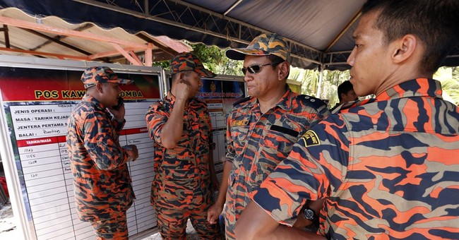 Malaysia searches for 26 missing after boat sinks