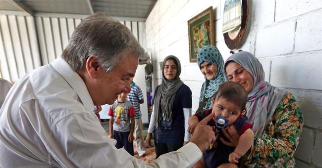 AP PHOTOS: Glimpse at refugees, as UN count surges