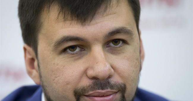 Russian buildup seen as fighting rages in Ukraine