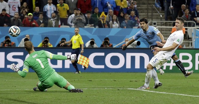 Suarez pushes England to edge of World Cup exit