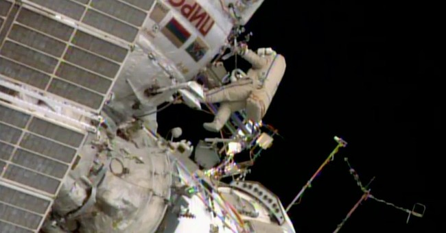 Spacewalkers complete tiring work at space station