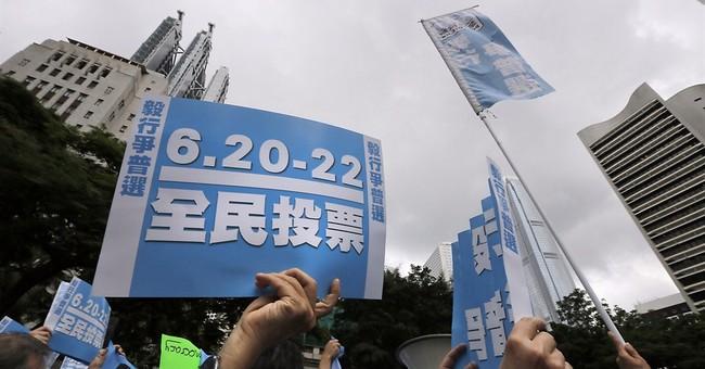 HK in unofficial democracy vote, alarming Beijing