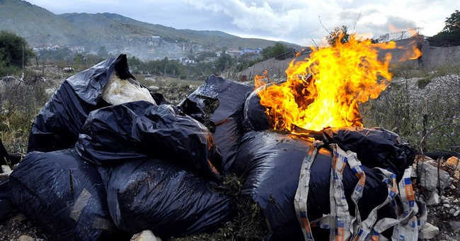 Drug, gun haul grows from lawless Albanian village