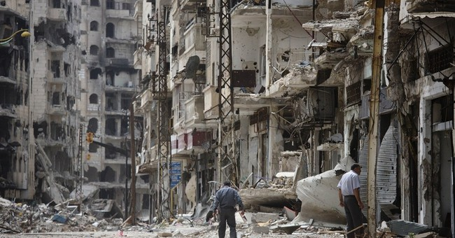 Syrians return to city shattered by war