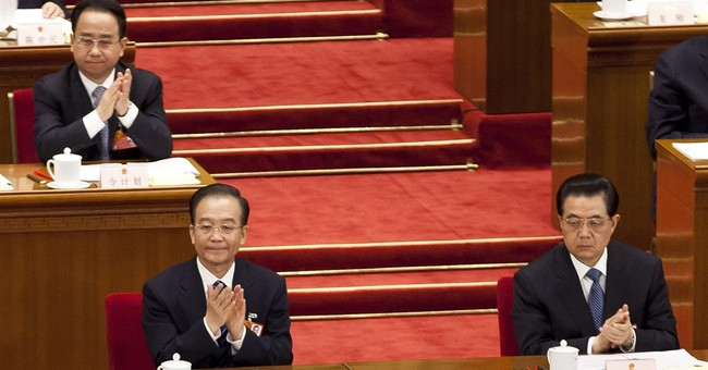 China investigates brother of ex-president's aide