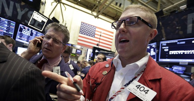 Stocks manage small gains; Dow, S&P 500 at records