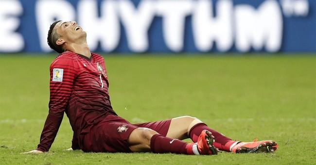 US draws, Belgium advances, Algeria wins