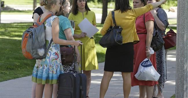 Mormon woman facing excommunication holds vigil