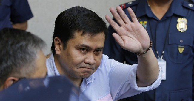 Philippine senator charged with plunder surrenders
