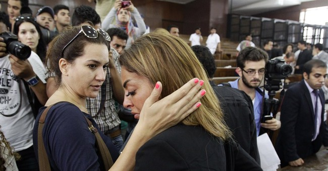 Egypt president refuses pardon for journalists