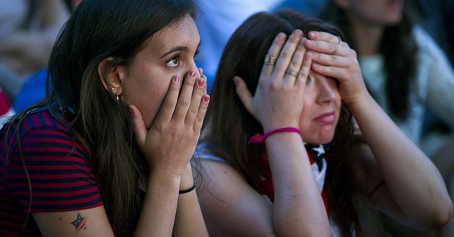 AP PHOTOS:  US fans see 'cruel' side of soccer