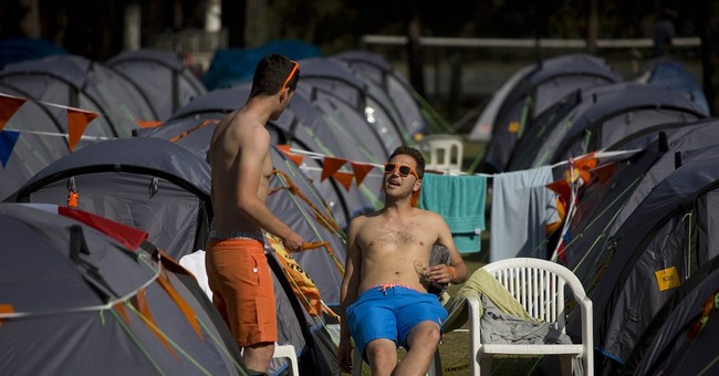 In Brazil camp for Dutch fans, color helps unite