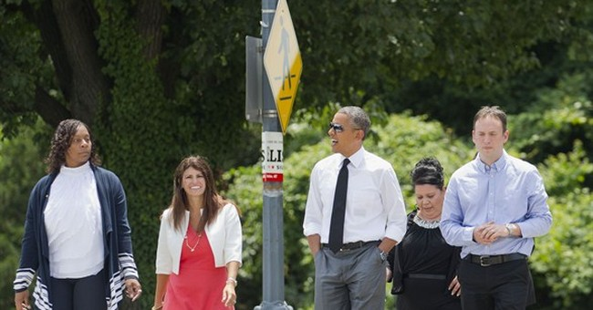 Obama says US should have paid maternity leave