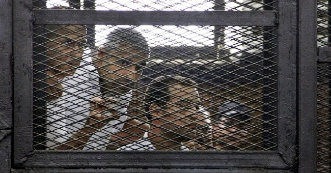 Outcry after Egypt sentences 3 reporters to prison