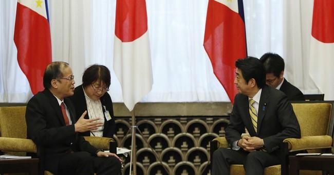 Philippine leader backs larger Japan military role