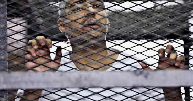 Thumbnails of the 3 jailed Al-Jazeera journalists