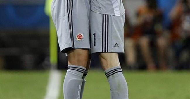 Uruguay beats Italy to advance; Greece late winner