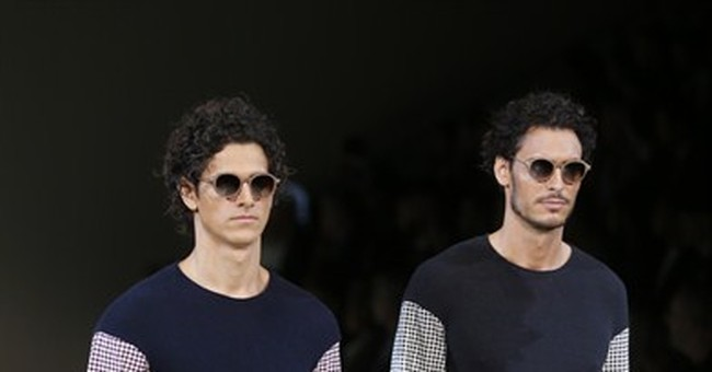 Milan designers nudge men to dress with derring-do